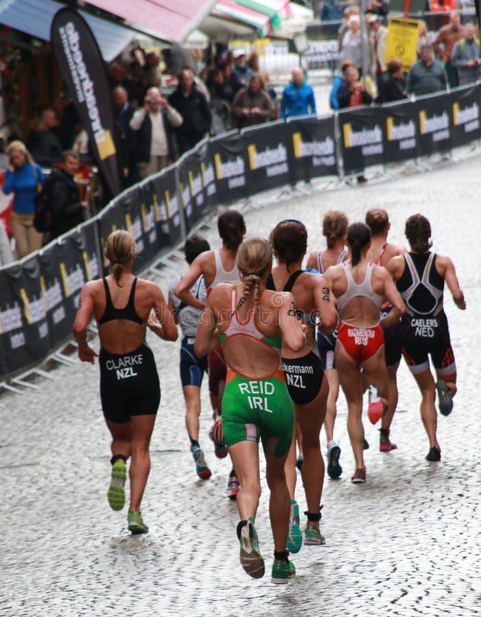 Reid, Clarke - running. STOCKHOLM - AUG 23: Triathlete Reid (IRL), Clarke (NZL), Caelers (NED) , Ackerman (NZL), in the Women's ITU World Triathlon series event royalty free stock photo