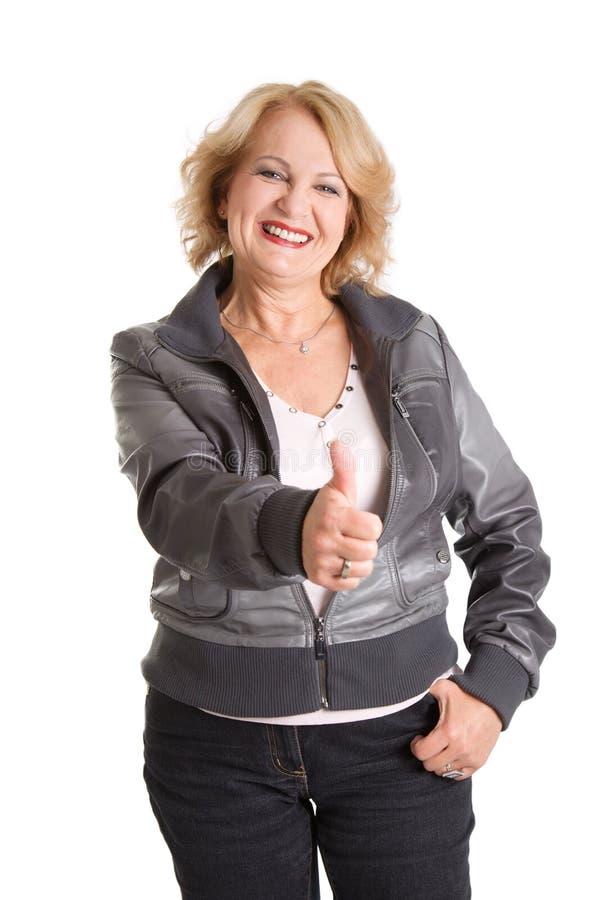 Reife ältere Frau der Frauendaumen oben - lokalisiert auf weißem backgroun stockbilder