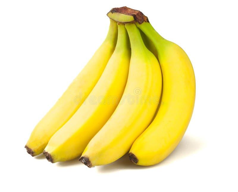 Reife Bananen auf weißem Hintergrund stockfotografie