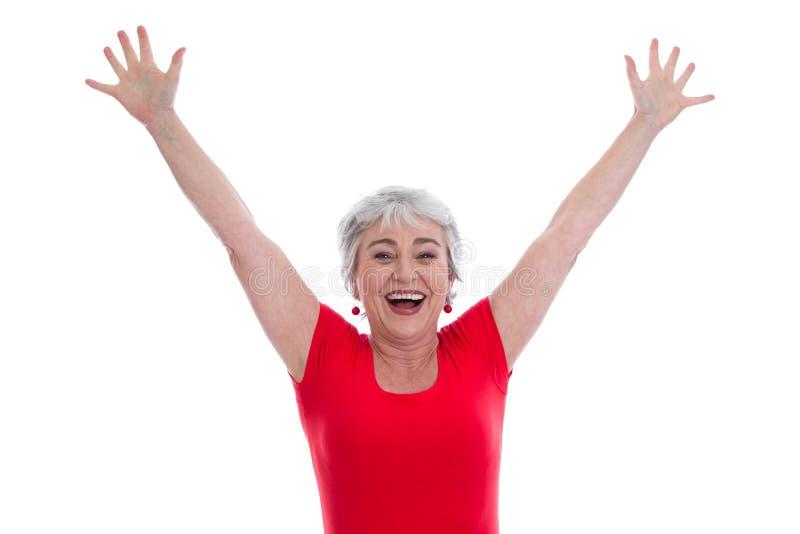 Reife Dame glücklich in rot- lokalisiert auf Weiß lizenzfreie stockfotografie