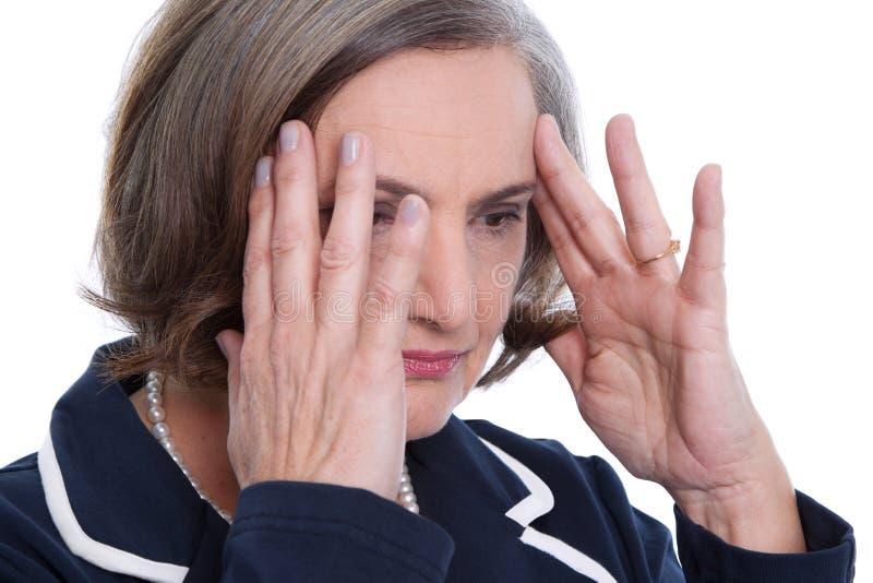 Reife Damenkopfschmerzen stockfotografie