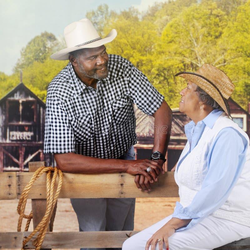 Reifer Cowboy Flirting stockbilder