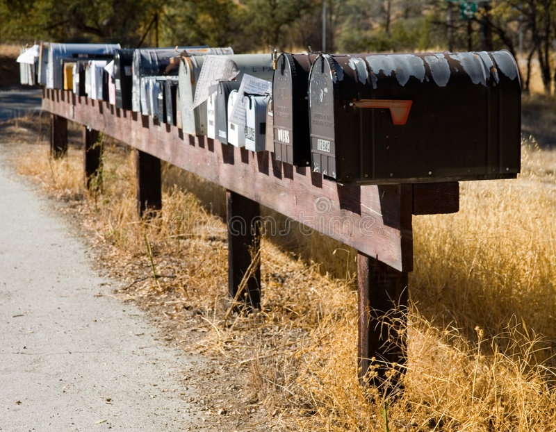 Reihe der landwirtschaftlichen Mailboxes lizenzfreie stockbilder