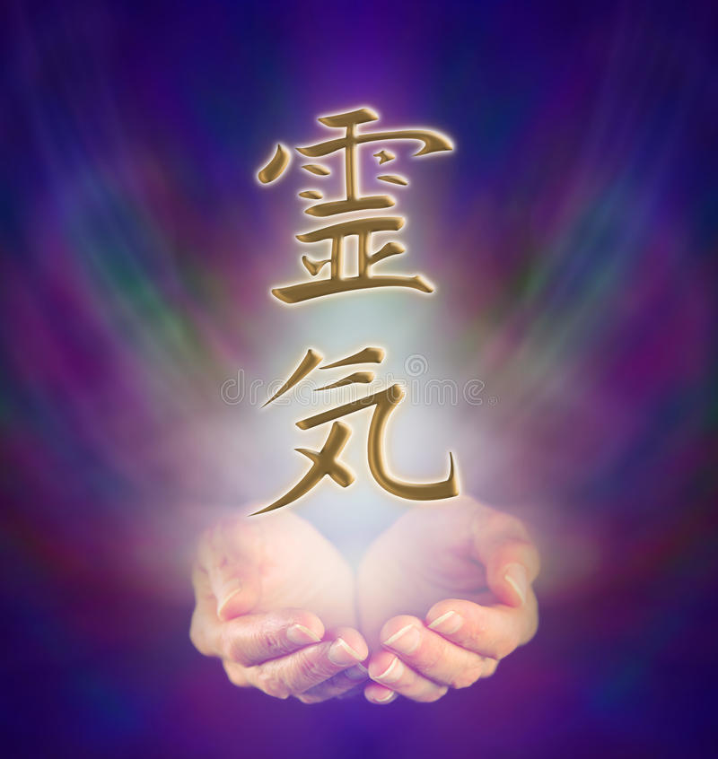 Reiki Kanji and cupped hands. Healers cupped hands and Reiki Kanji Symbol on misty background stock photos
