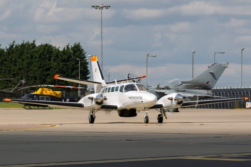 Reims F406 Cessna 406 G-MAFB operou-se Directflight BRITÂNICO Ltd da pesca de mar em missões da patrulha marítima fotografia de stock
