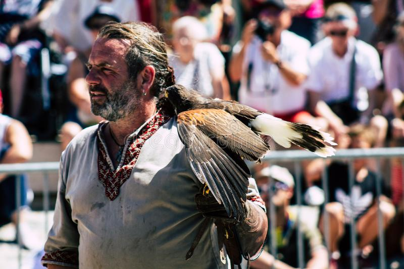 Colors of France. Reims France June 2, 2019 Closeup of a falconer and a raptor participating in a falconry show in the streets of Reims in the afternoon royalty free stock photo