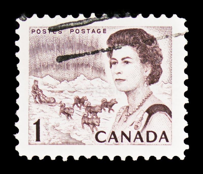 Reina Elizabeth II, aurora boreal y equipo del trineo del perro, serie centenario 1967-71 de Definitives, circa 1968 fotos de archivo libres de regalías