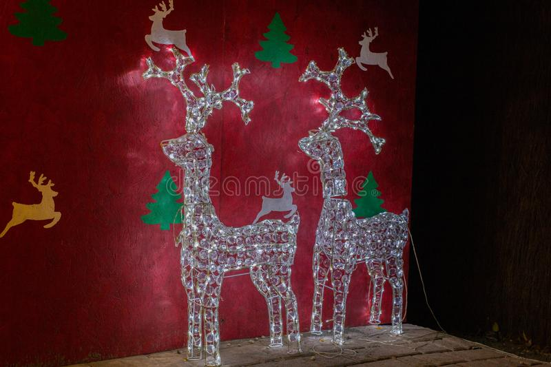 Reindeer christmas lights. With red background royalty free stock photo