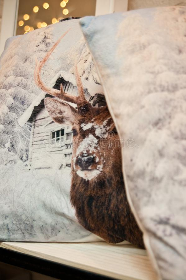 Reindeer on cushions royalty free stock photography