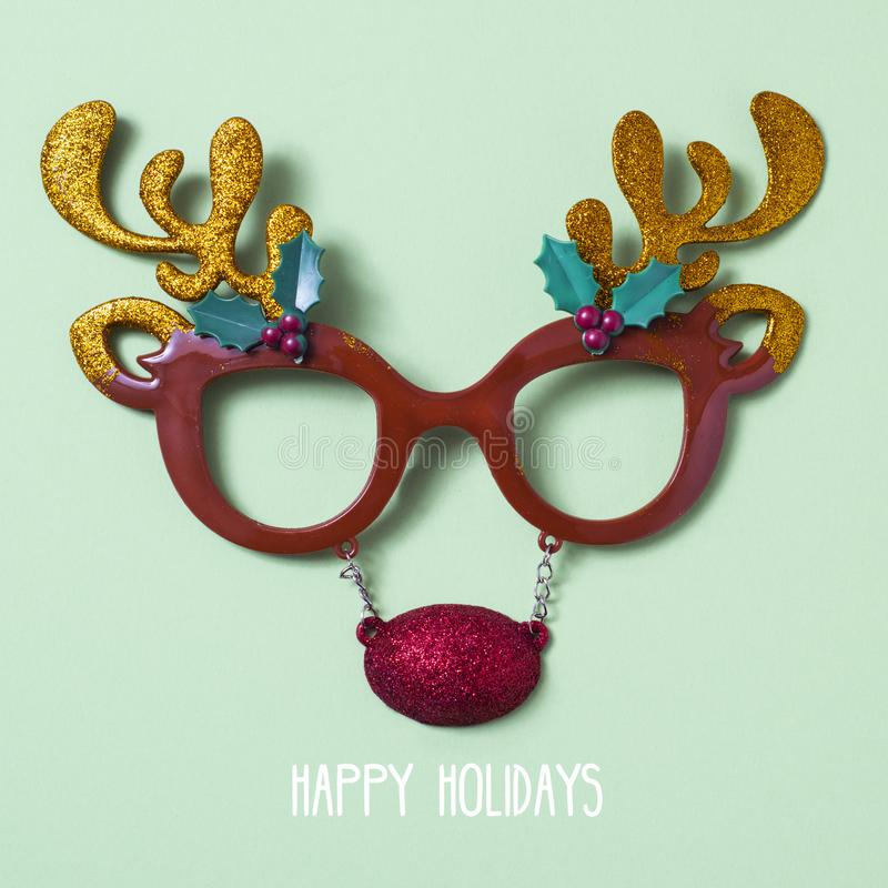 Reindeer eyeglasses and text happy holidays royalty free stock images