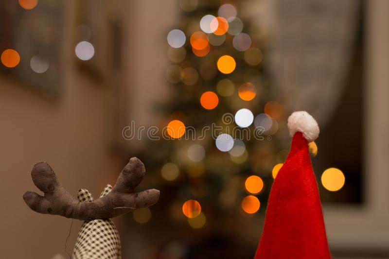 Reindeer and Santa Claus puppets. With lights in the background royalty free stock photo
