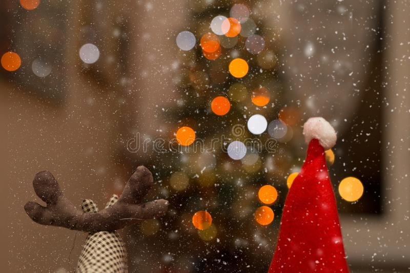 Reindeer and Santa Claus. With lights and snow royalty free stock images