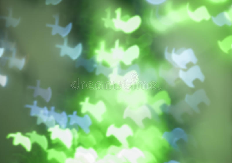 Reindeer shaped bokeh lights in green and blue royalty free stock photos