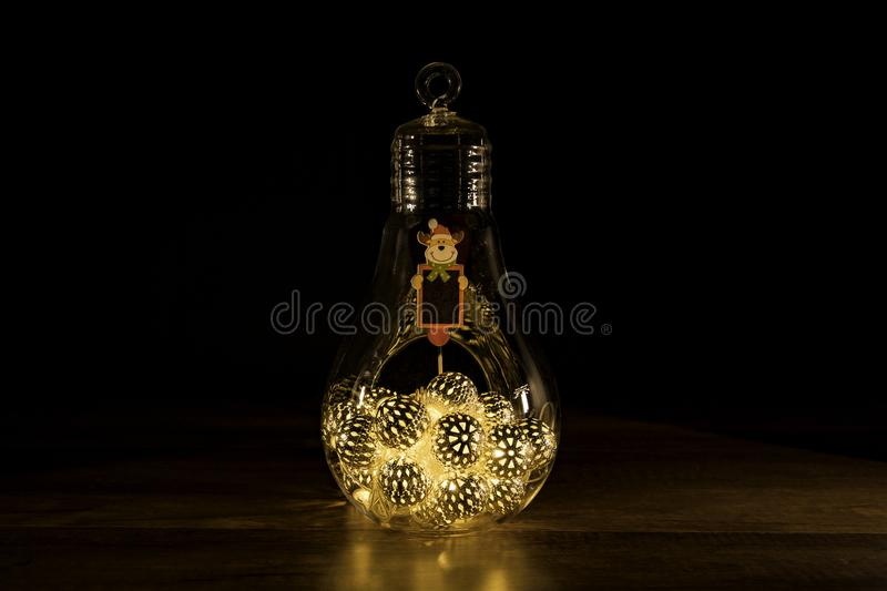 Reindeer sign with Christmas lights in glass light bulb royalty free stock photo