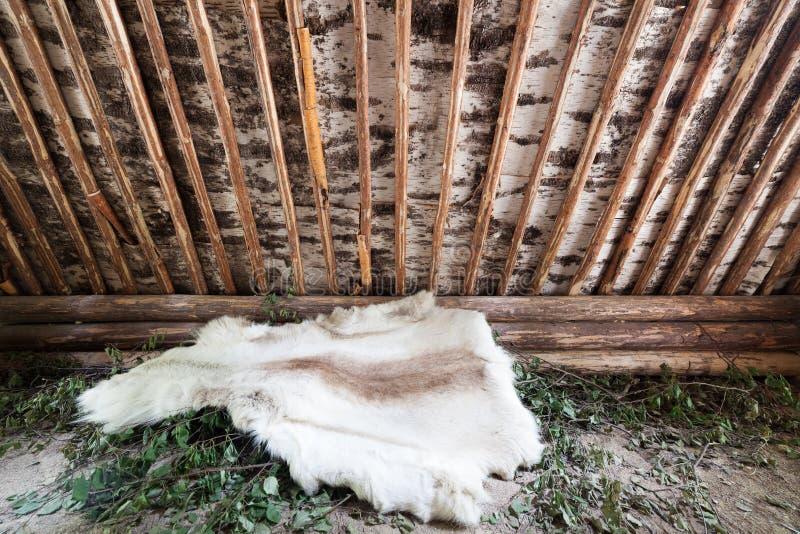 Reindeer skin in birch bark hut royalty free stock images