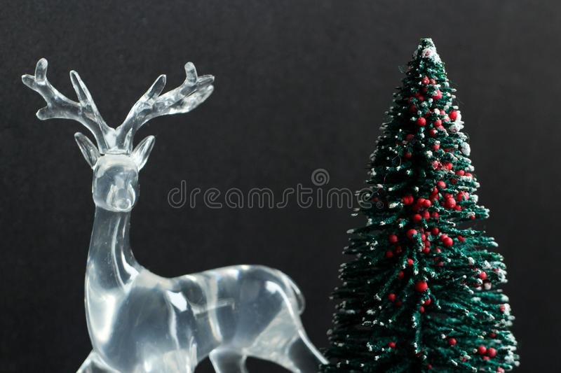 Reindeer statue with Christmas tree stock photography