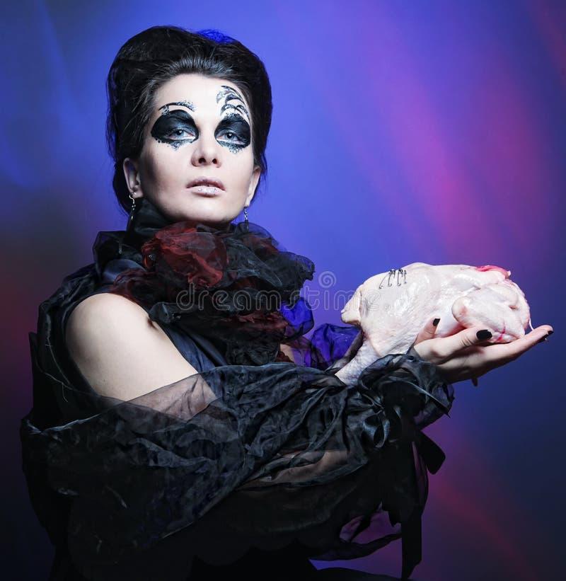 Reine de Veille de la toussaint avec la carcasse de poulet photographie stock libre de droits