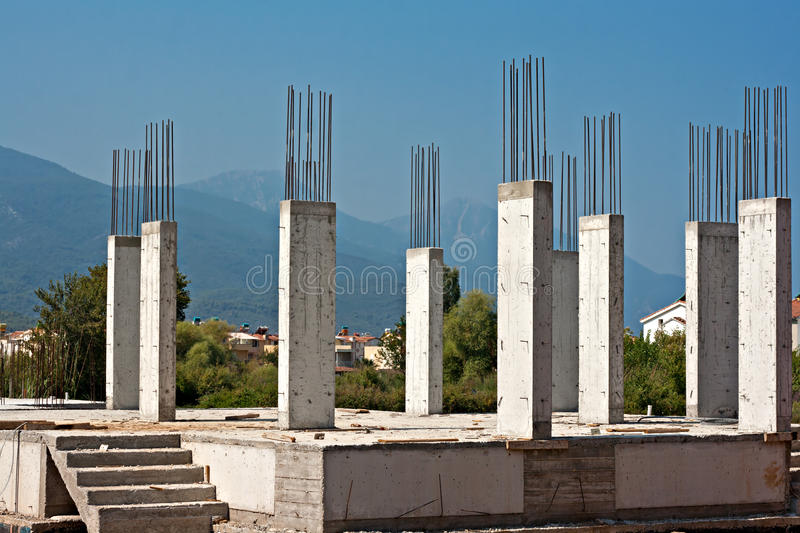 Building A House On Pillars : Reinforced concrete pillars on building site stock image