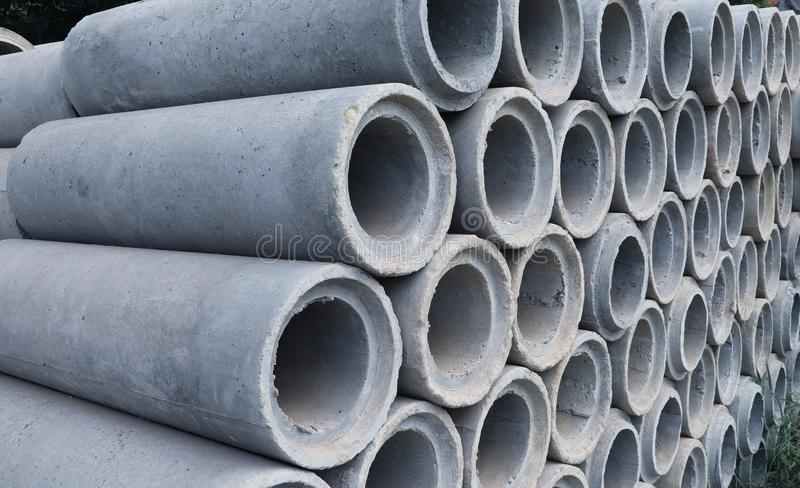 Reinforced concrete pipe stacking on the floor. Ready to be collected for construction work royalty free stock photography