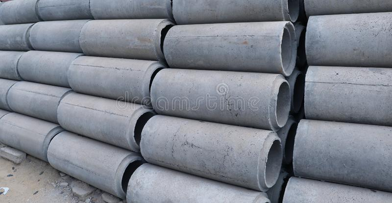 Reinforced concrete pipe stacking on the floor. Ready to be collected for construction work royalty free stock photo