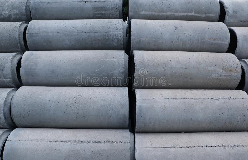 Reinforced concrete pipe stacking on the floor. Ready to be collected for construction work stock image
