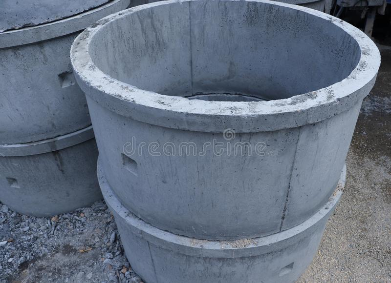 Reinforced concrete pipe stacking on the floor. Ready to be collected for construction work royalty free stock photos