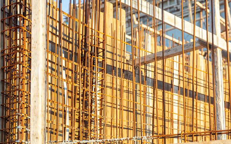Reinforced concrete, under construction. Formworks and steel bars reinforcement in a construction site. Closeup view royalty free stock photos