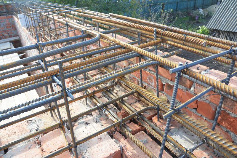 Reinforcement corner concrete bars with wire rod. Brickwork with iron bars for house construction. Reinforcement corner concrete bars with wire rod. Brickwork stock image
