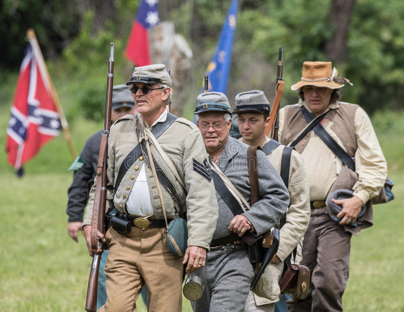 Reinforcemtns Move Up. Civil War era soldiers move up to the lines during a battle at the Dog Island reenactment in Red Bluff, California stock photography