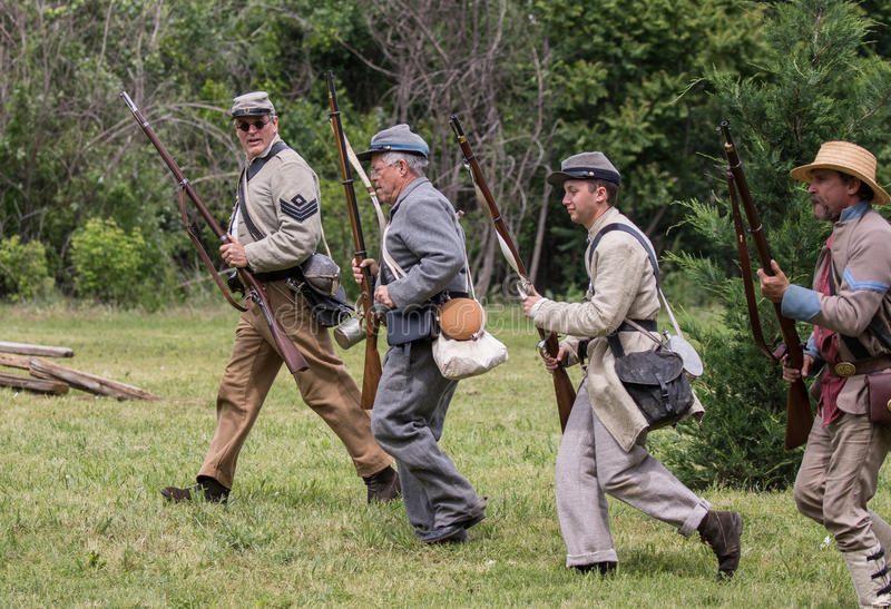 Reinforcemtns Move Up. Civil War era soldiers move up to the lines during a battle at the Dog Island reenactment in Red Bluff, California royalty free stock photography