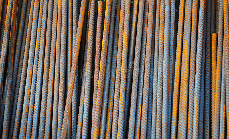 Reinforcing bar, or rebar, is a common steel bar that is hot rolled and is used widely in the construction industry, especially fo royalty free stock image