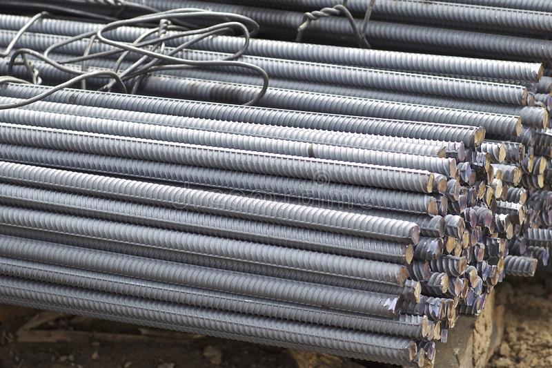 Reinforcing bars with a periodic profile in the packs are stored in the metal products warehouse royalty free stock photo