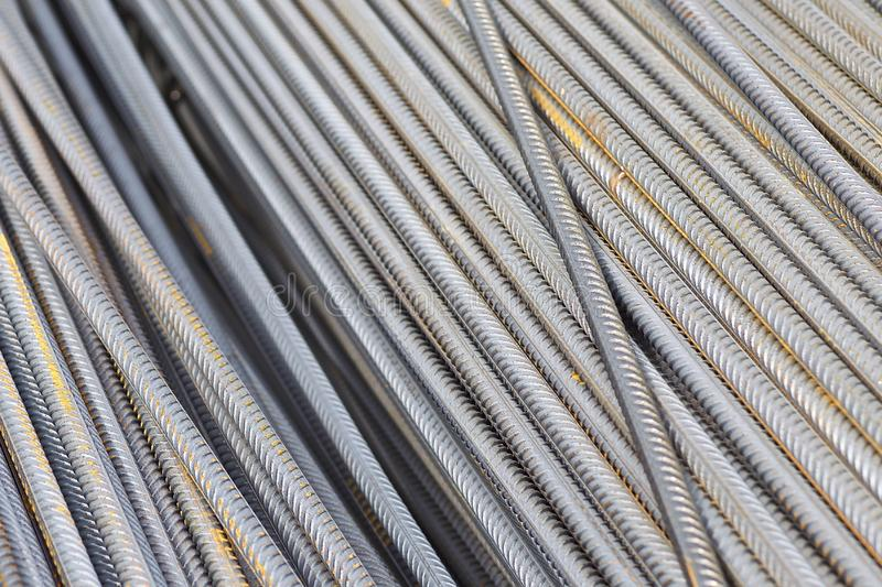 Reinforcing bars with a periodic profile in the packs are stored in the metal products warehouse stock photos