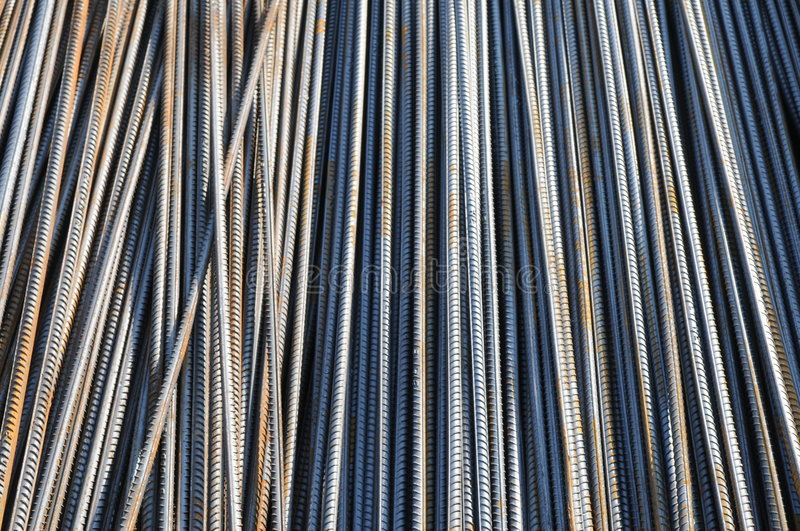 The reinforcing steel bars. With threads in bundles background stock photos