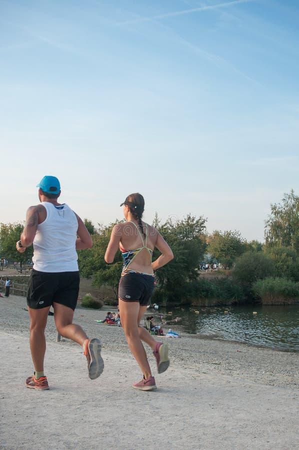 Couple running in border lake stock photo