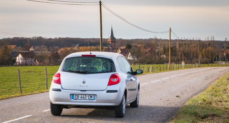 Car driving on a small country road in the Vosges moutains stock images