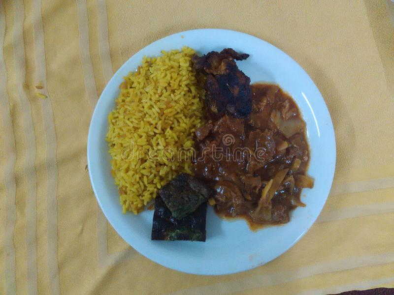 Reis mit Kreuzkümmel und tajine lizenzfreie stockfotos