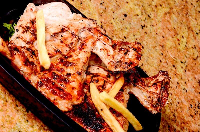 Reisabdeckung und gebratenes Fleisch stockbilder