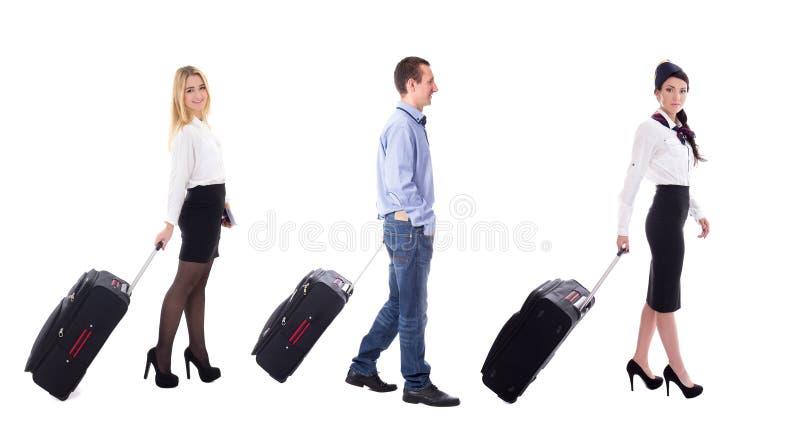 Reisconcept - zijaanzicht van lopende stewardess en toeristenwi stock afbeeldingen
