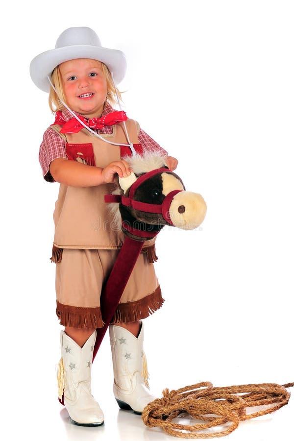 Reiten Sie sie Cowgirl lizenzfreie stockbilder