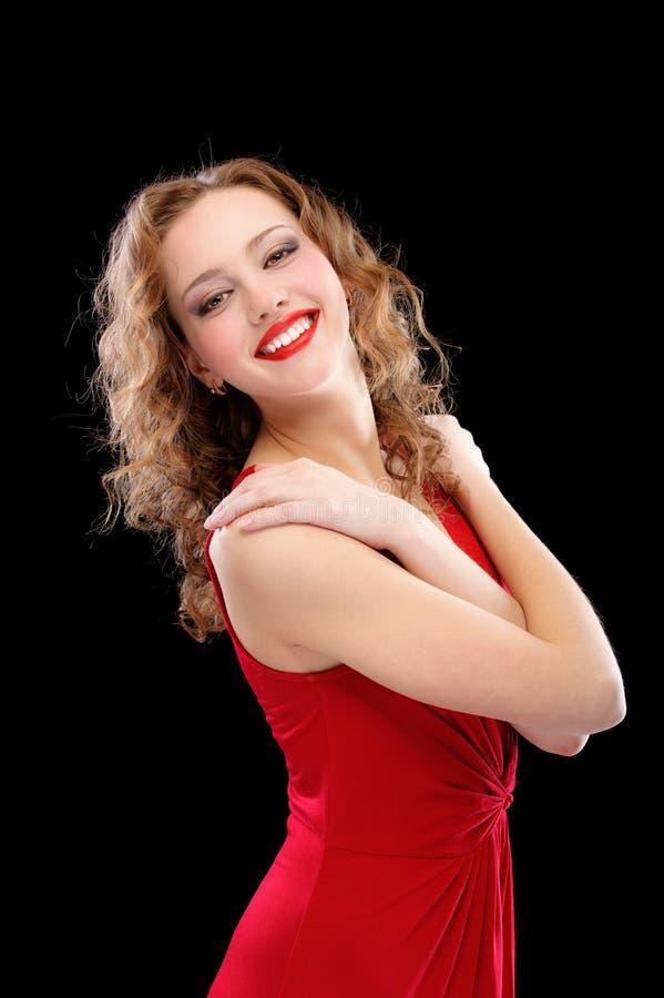 Reizend Dame im roten Abendkleid stockfotografie