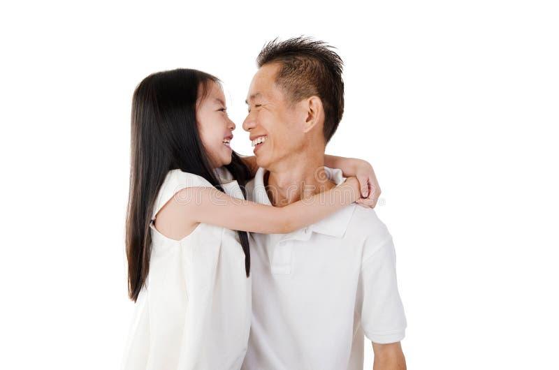 Reizende asiatische Familie stockfoto