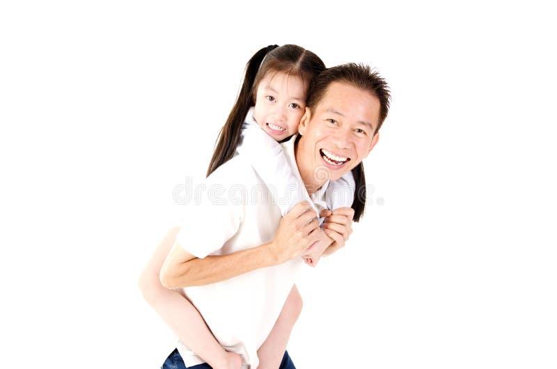 Reizende asiatische Familie lizenzfreie stockfotografie