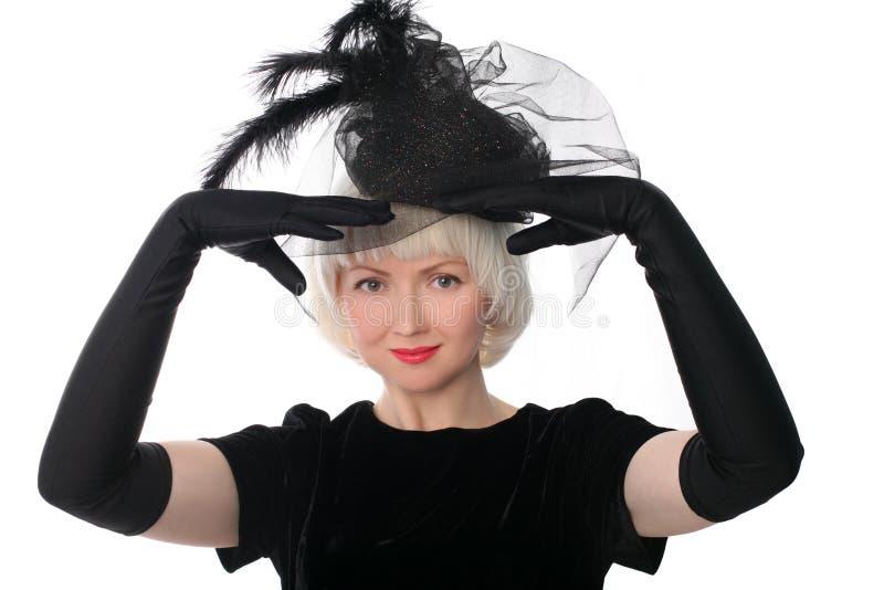 Reizende Frau in der Retro- Art stockfotografie