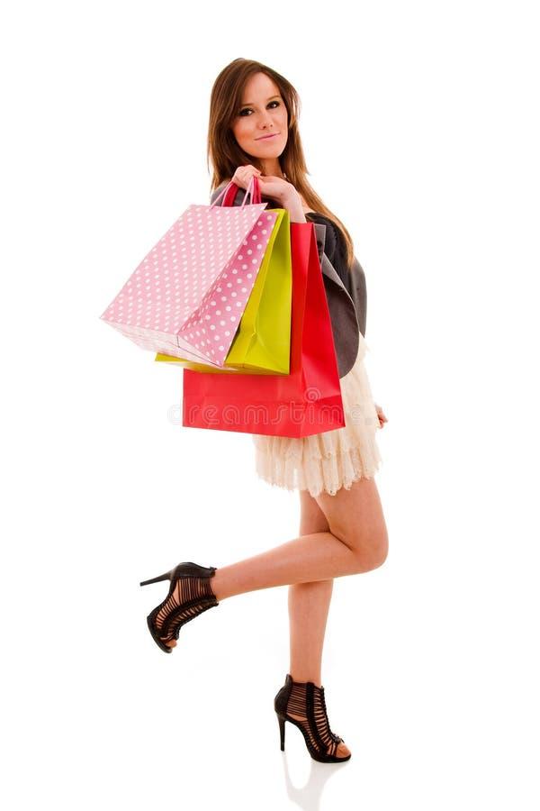 Reizende Frau mit Einkaufstaschen stockfotos