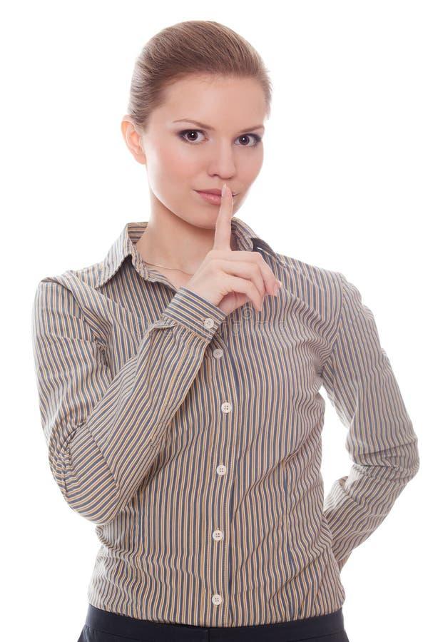 Reizende Geschäftsfrau, die ruhig Zeichen zeigt stockfotos