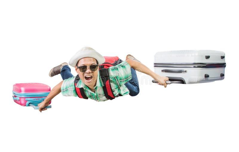 Reizende mens die met bagagezak vliegen die geïsoleerde witte bedelaars drijven stock afbeeldingen