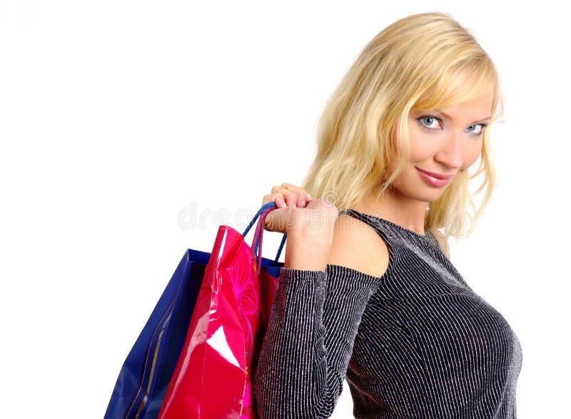 Reizvolle Einkaufenfrau lizenzfreies stockfoto