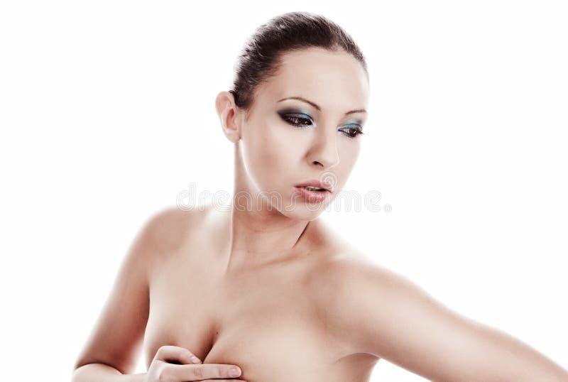 Reizvolle Frau auf Weiß stockbilder