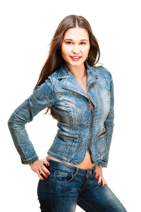 Reizvolle Frau in der Jeansjacke lizenzfreie stockbilder